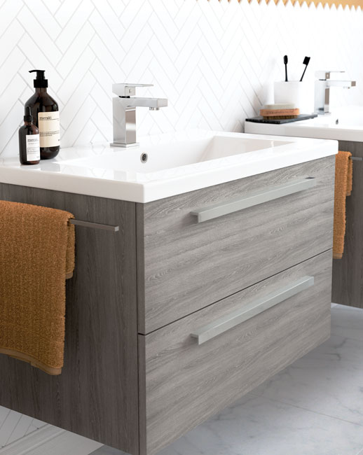 Vanity units include a towel rail